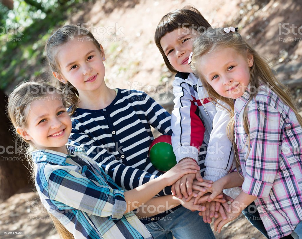 Happy little friends in city park stock photo