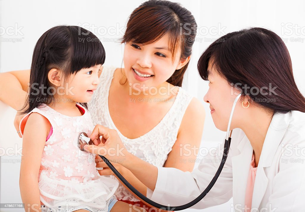 happy Little girl and  doctor in hospital having examinatio stock photo