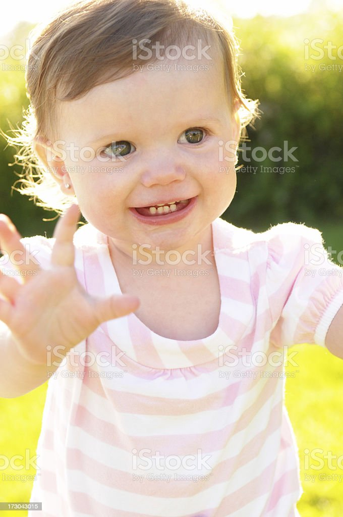 Happy Little Girl Backlit by the Evening Sun royalty-free stock photo