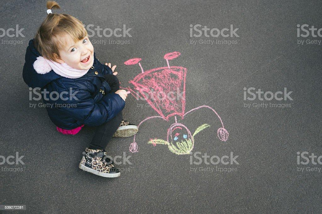 Happy Little Girl Chalking stock photo