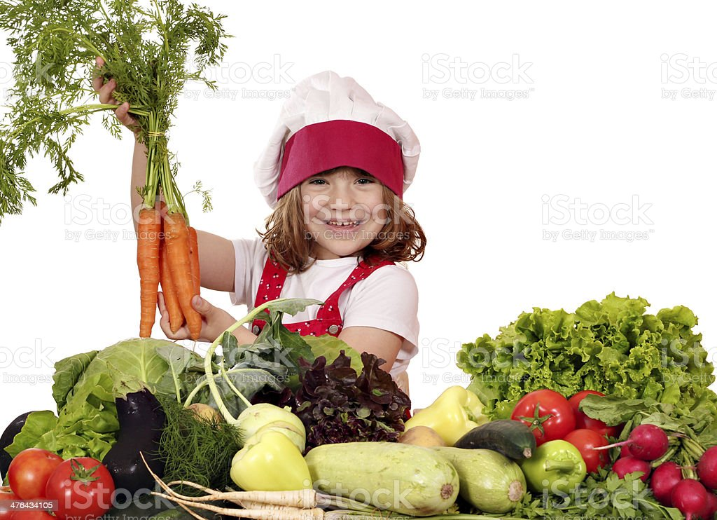 happy little girl cook holding carrot royalty-free stock photo