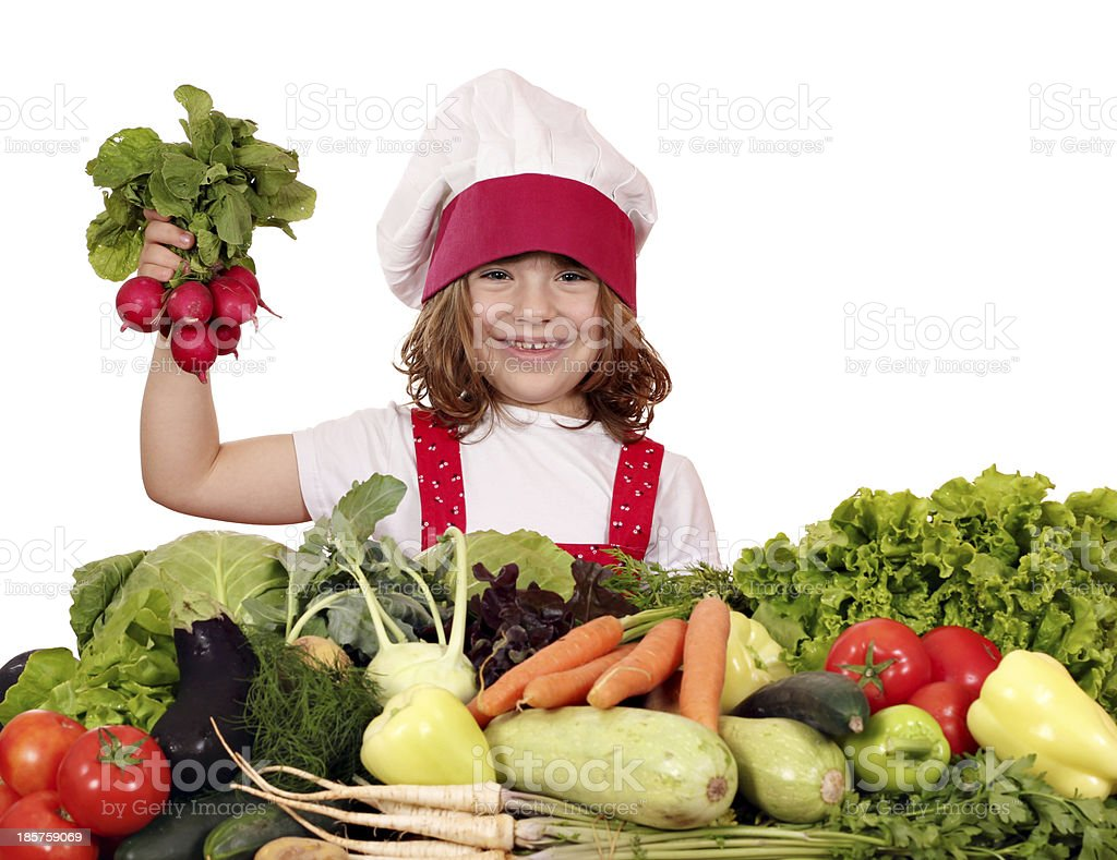 happy little girl cook holding radish vegetables royalty-free stock photo