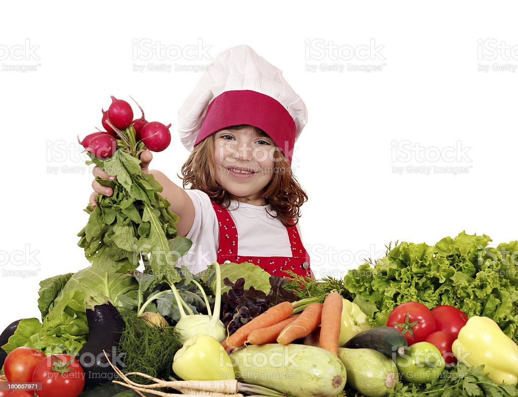 happy little girl cook with radish and vegetables royalty-free stock photo