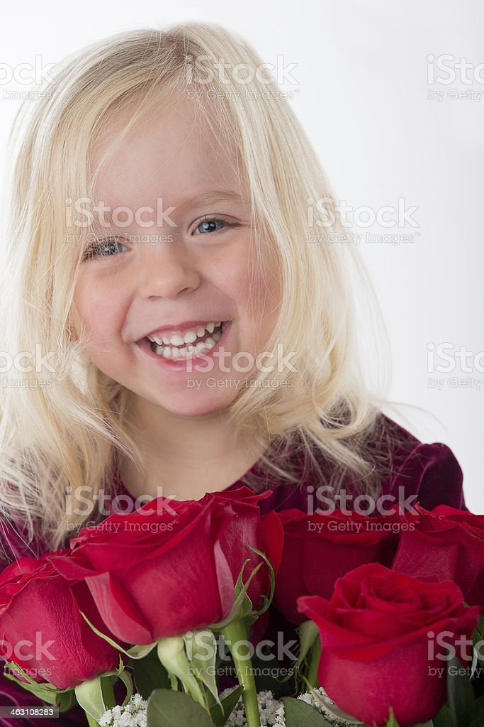 Happy little girl holding bouquet of flowers. royalty-free stock photo