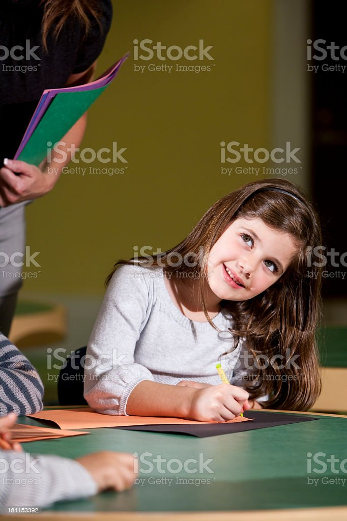 Happy little girl in classroom stock photo
