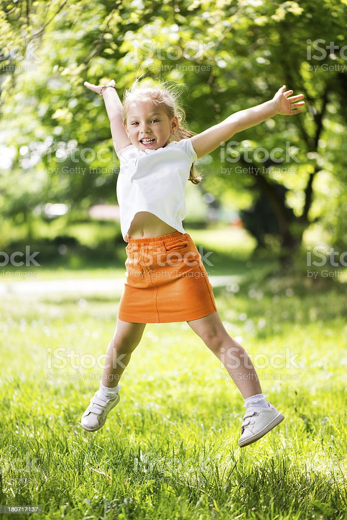 Happy Little Girl in The Park royalty-free stock photo