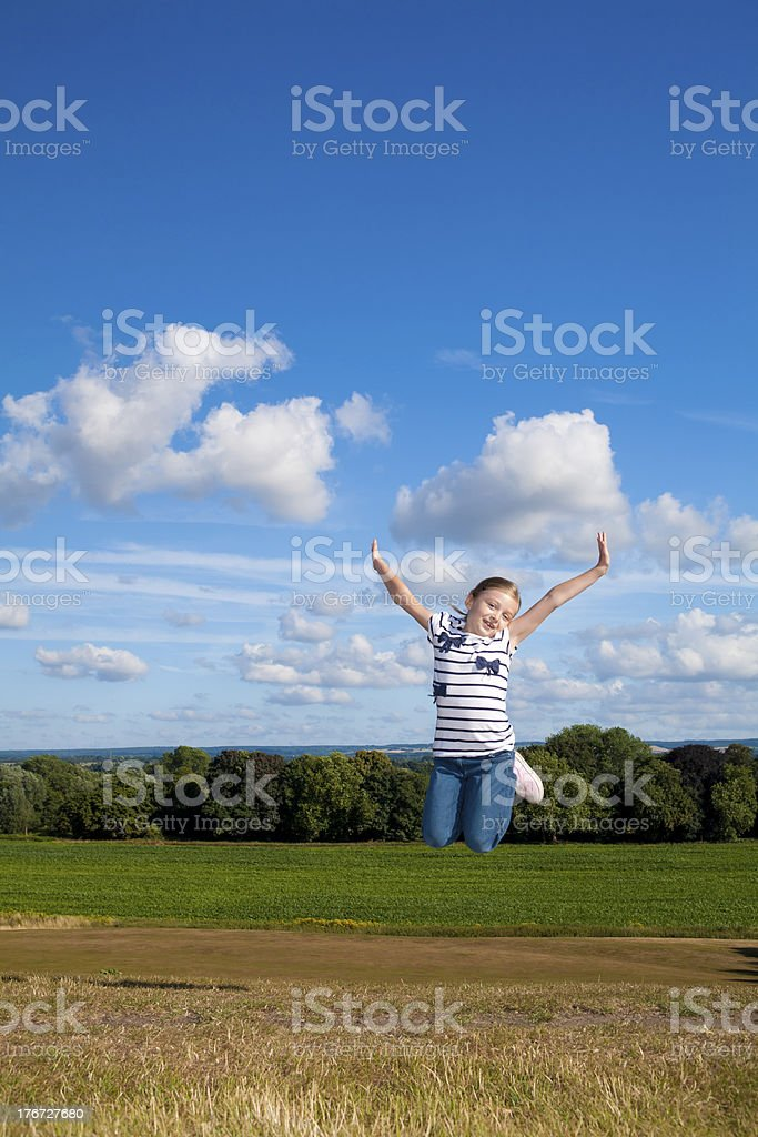 Happy little girl jumping for joy royalty-free stock photo