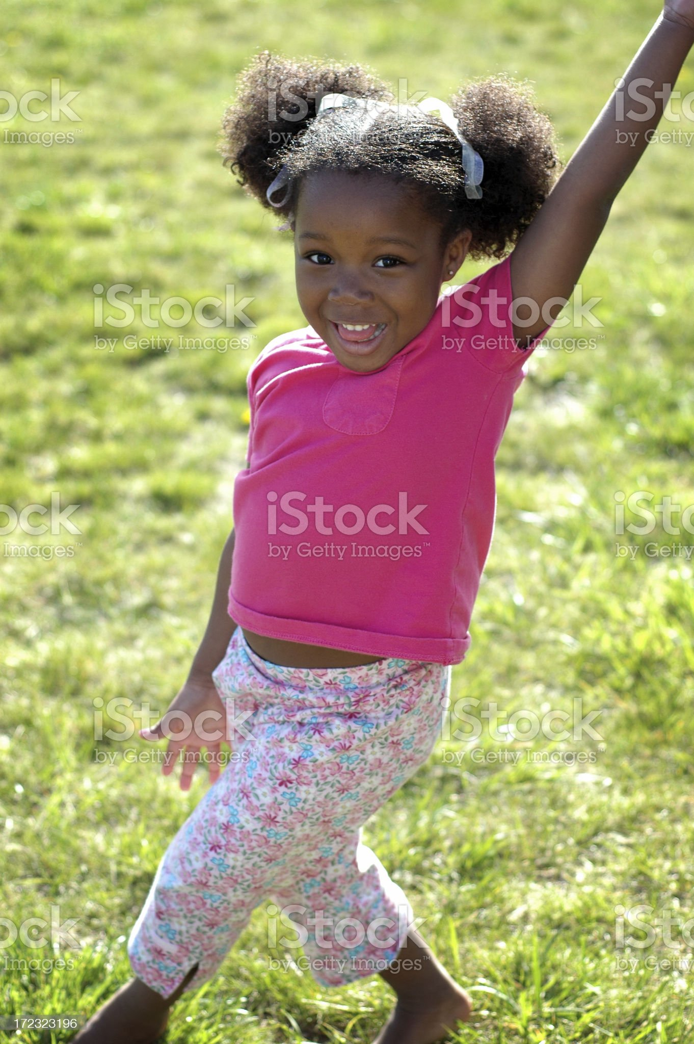Happy Little Girl Laughing Outside royalty-free stock photo