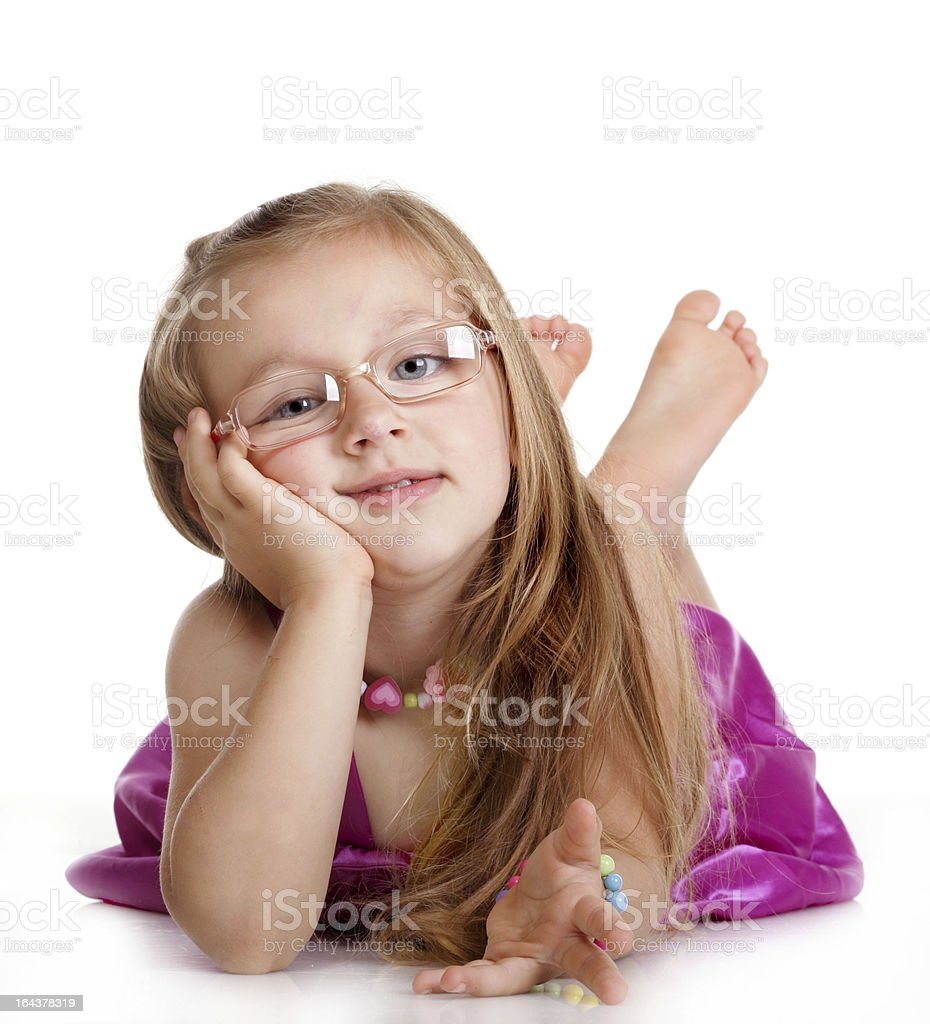 Happy little girl laying on floor isolated royalty-free stock photo