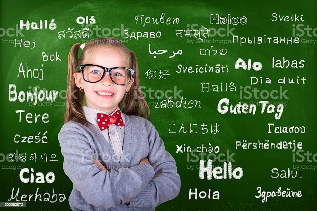 Happy little girl learn multi language stock photo