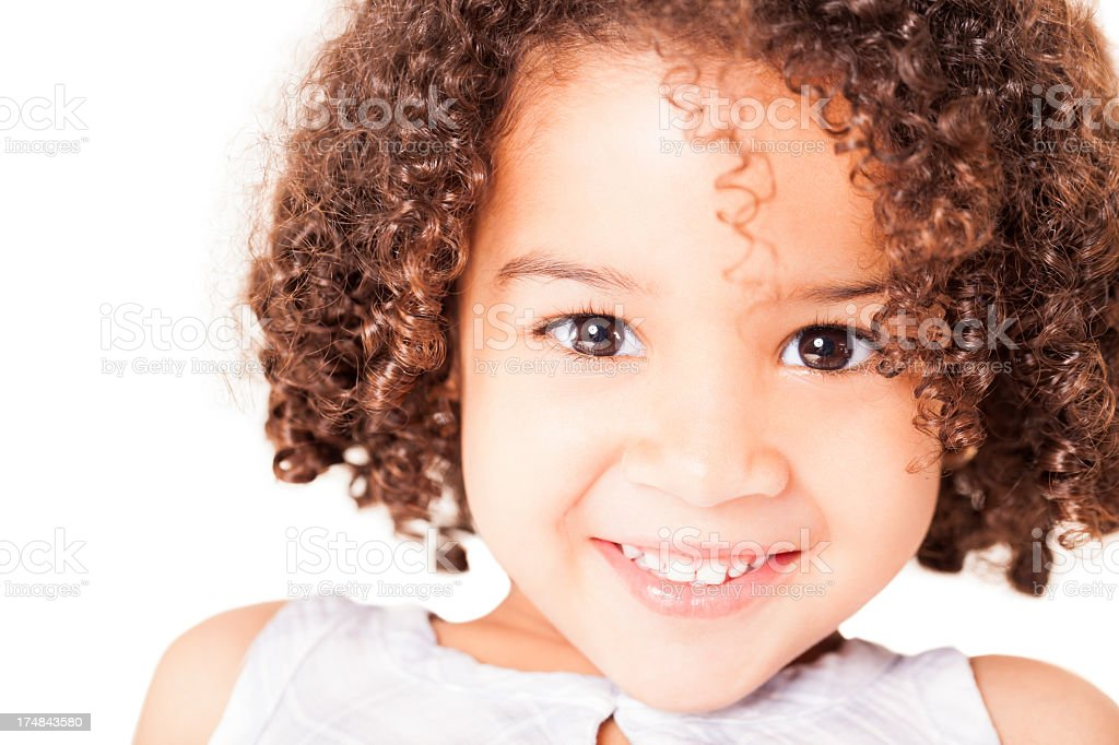 Happy little girl looking at camera royalty-free stock photo