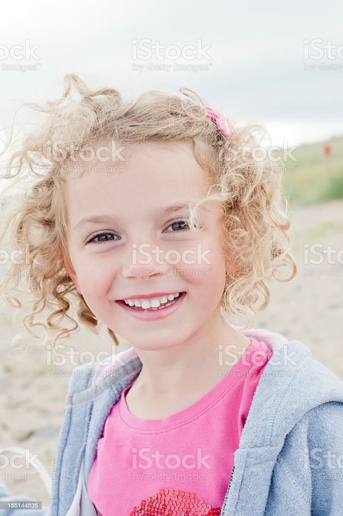 Happy Little Girl on a Windswept Beach royalty-free stock photo