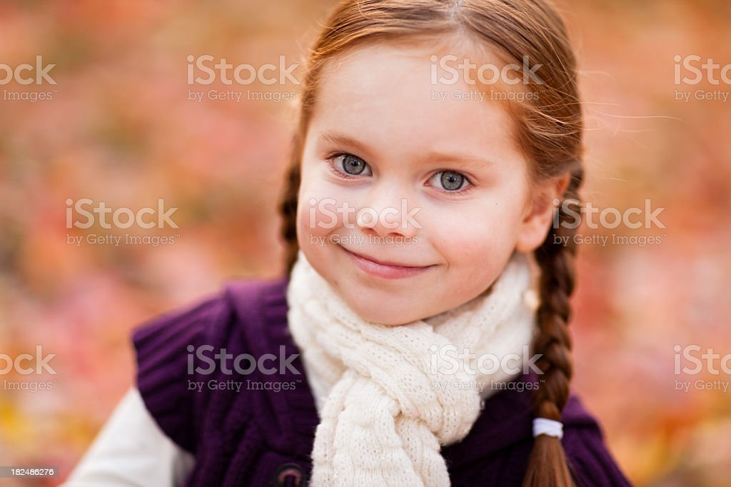 Happy Little Girl on an Autumn Day Outside royalty-free stock photo