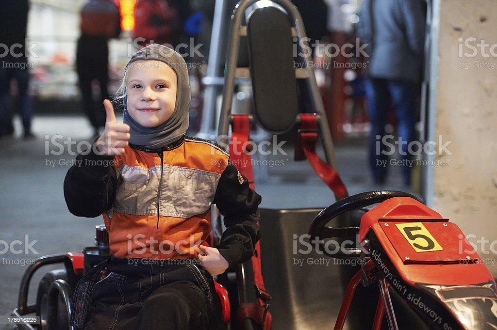 Happy little girl on karting stock photo