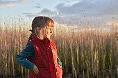 Happy little girl on  sunset