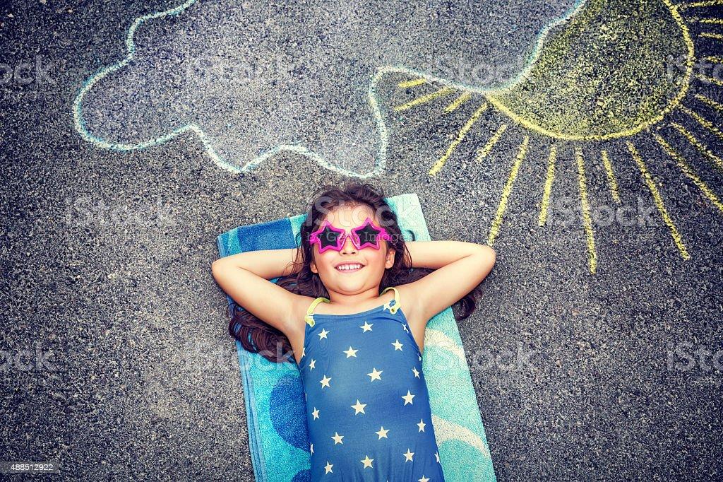 Happy little girl outdoors stock photo