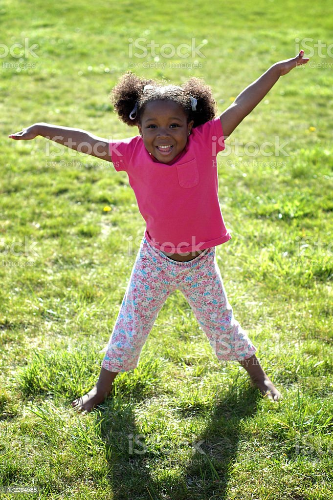 Happy Little Girl Playing Outside royalty-free stock photo