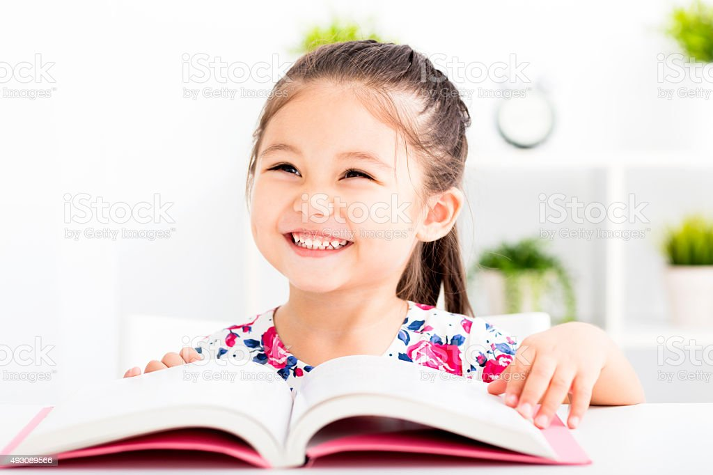 happy little girl Reading a Book stock photo