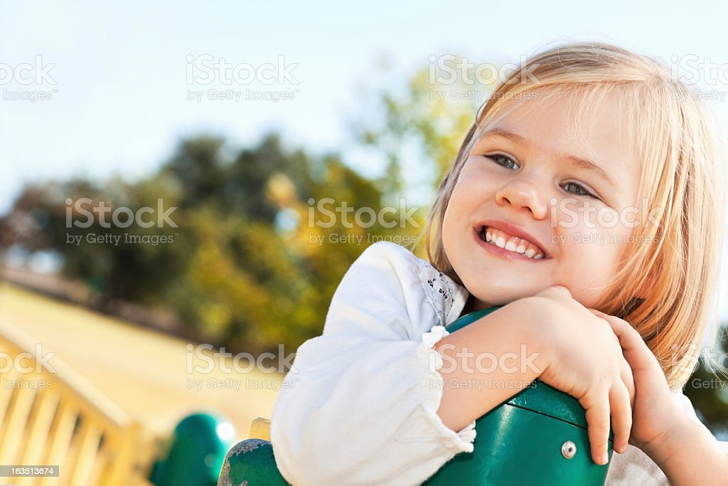 Happy Little Girl Resting at a Playground royalty-free stock photo
