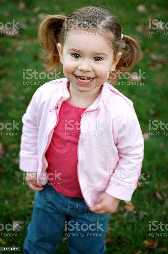 Happy Little Girl Smiling Outside royalty-free stock photo