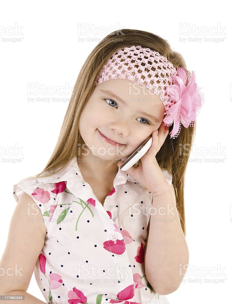 Happy little girl speaking by cell phone isolated royalty-free stock photo