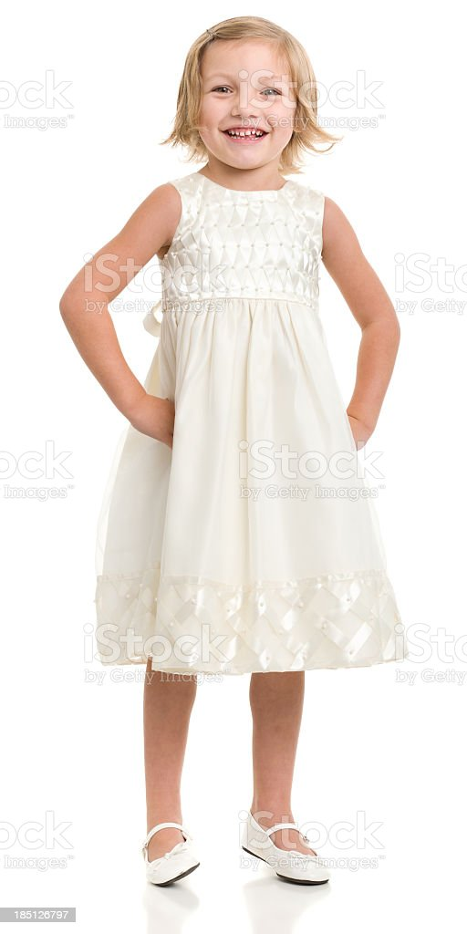 Happy Little Girl Standing In Dress stock photo