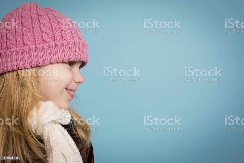 Happy Little Girl Wearing Hat and Scarf, with Copy Space royalty-free stock photo