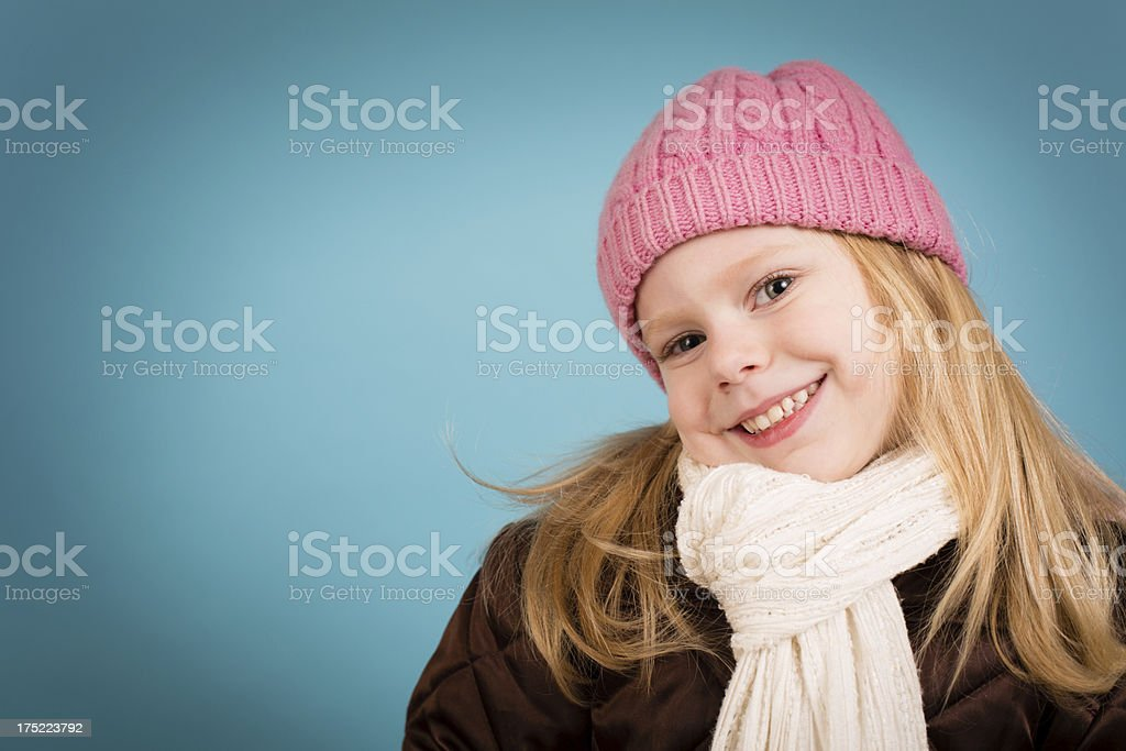 Happy Little Girl Wearing Knit Hat and Scarf royalty-free stock photo