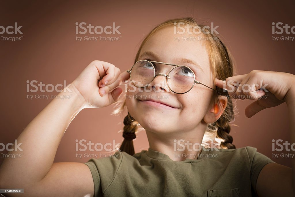 Happy Little Girl Wearing Vintage, Nerdy Glasses royalty-free stock photo