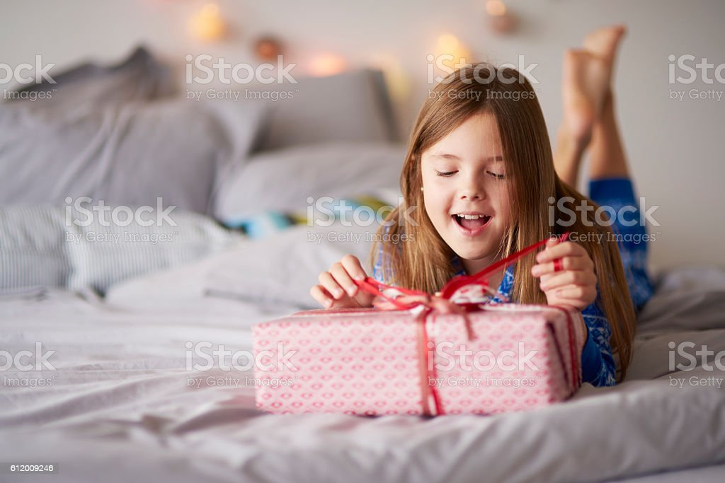 Happy little girl with Christmas present stock photo