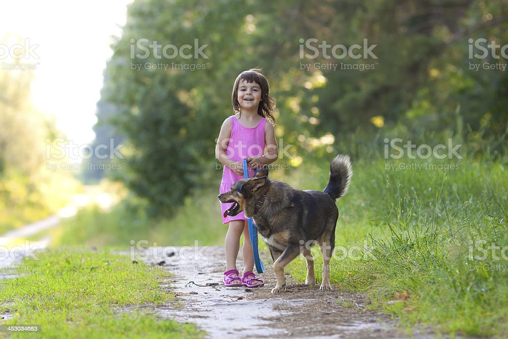 Happy little girl with dog royalty-free stock photo
