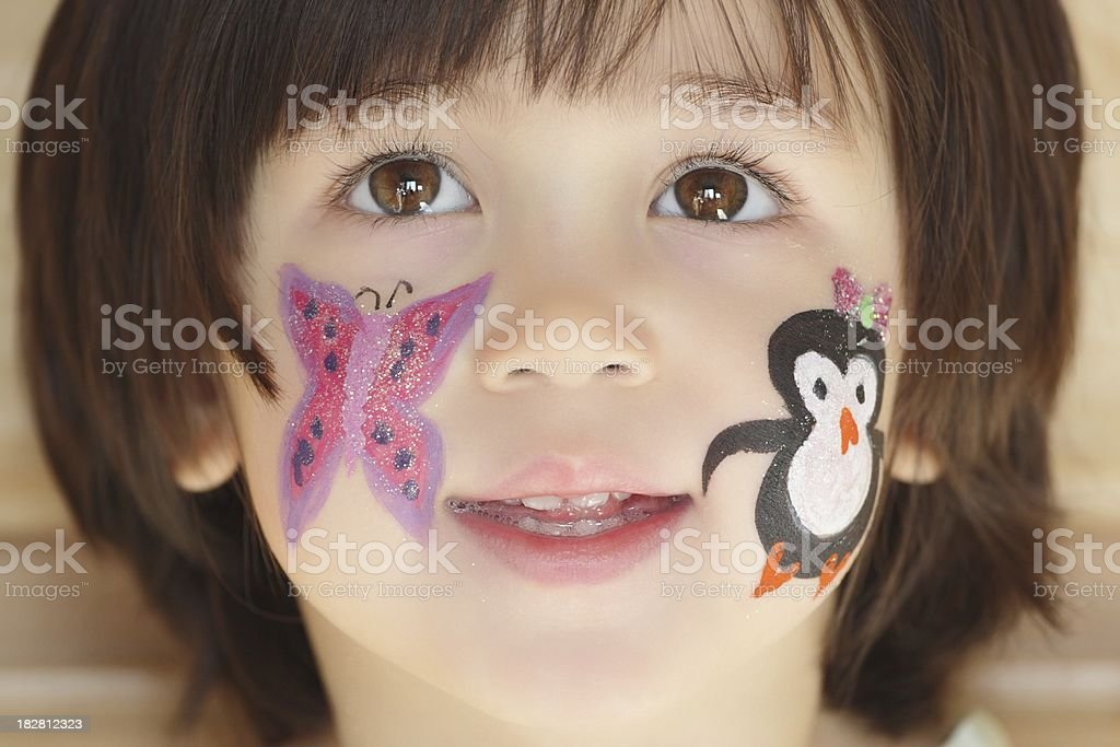 Happy Little Girl with Face Paint royalty-free stock photo