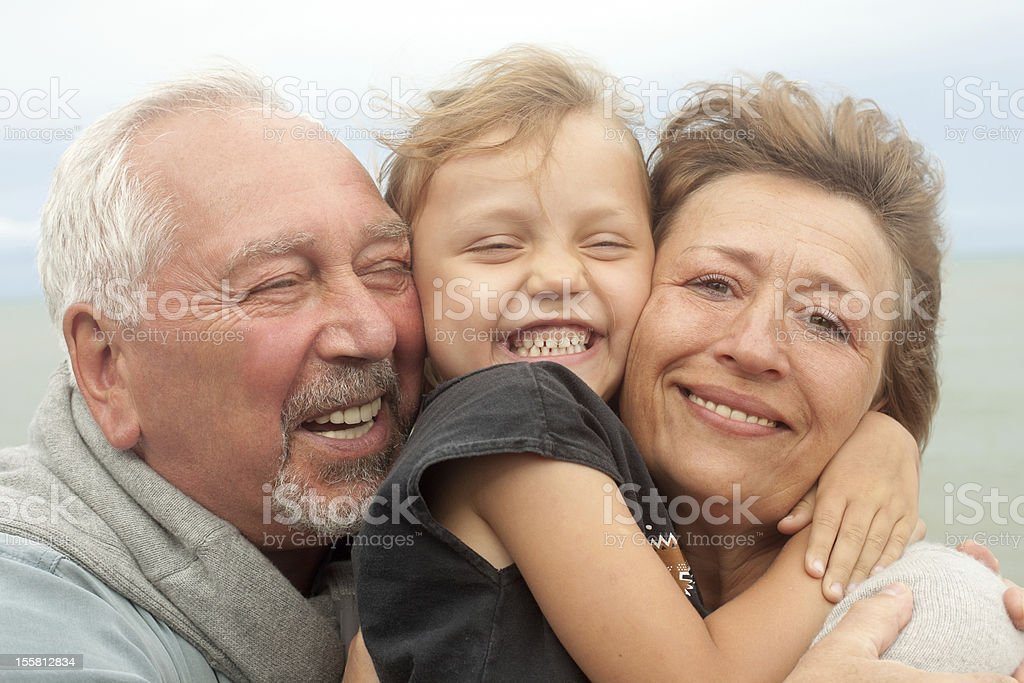 happy little girl with grandparents royalty-free stock photo
