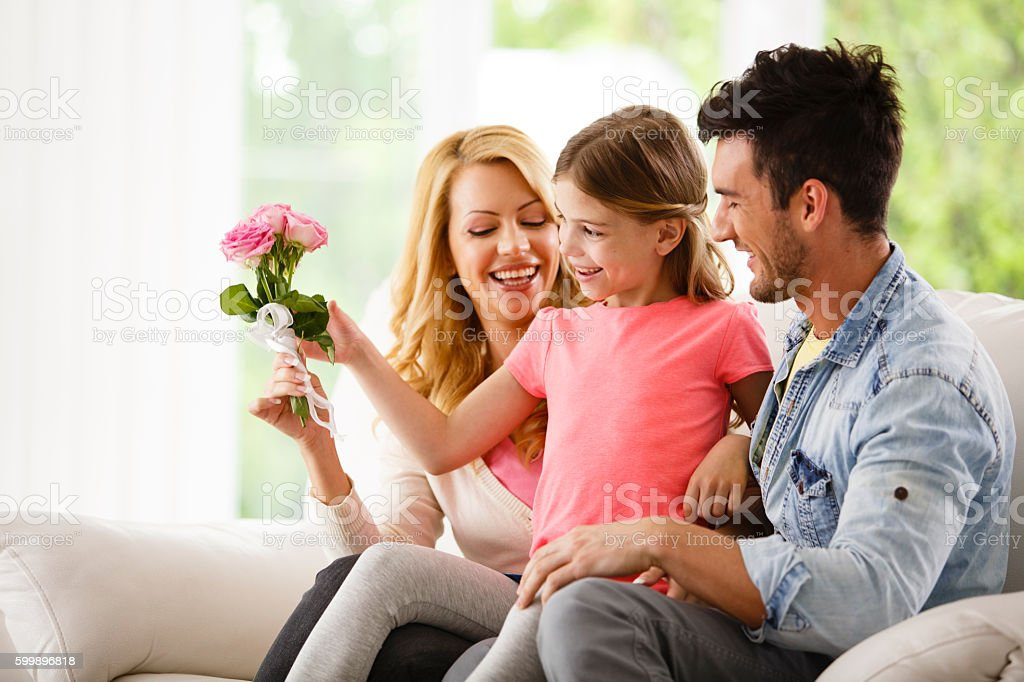 Happy little girl with her parents stock photo