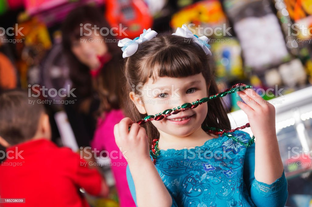 Happy Little Girl with Prizes royalty-free stock photo