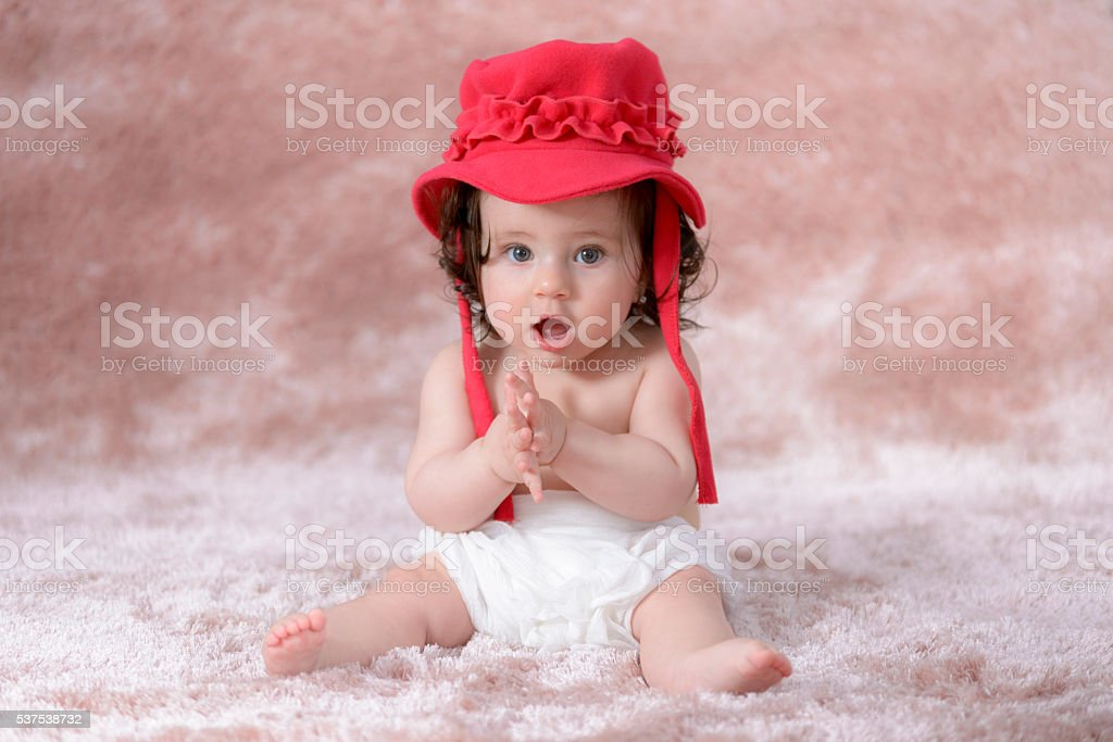 Happy little girl with red hat royalty-free stock photo