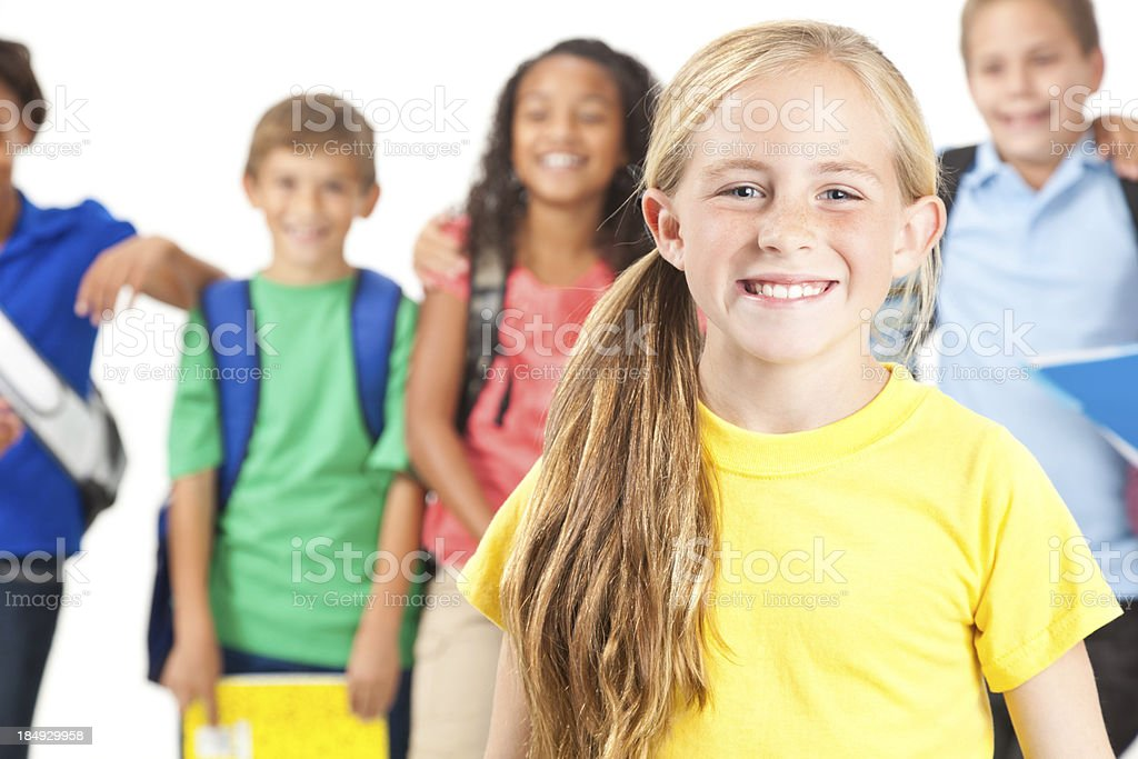 Happy little girl with school friends behind her royalty-free stock photo