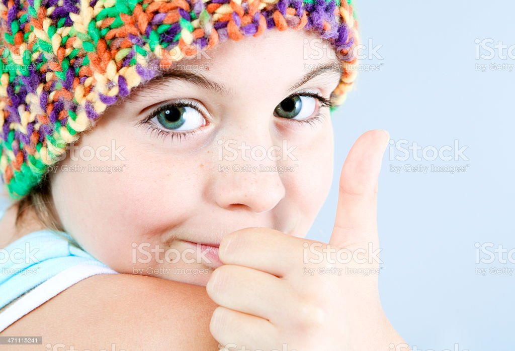 Happy little girl with thumbs Up royalty-free stock photo