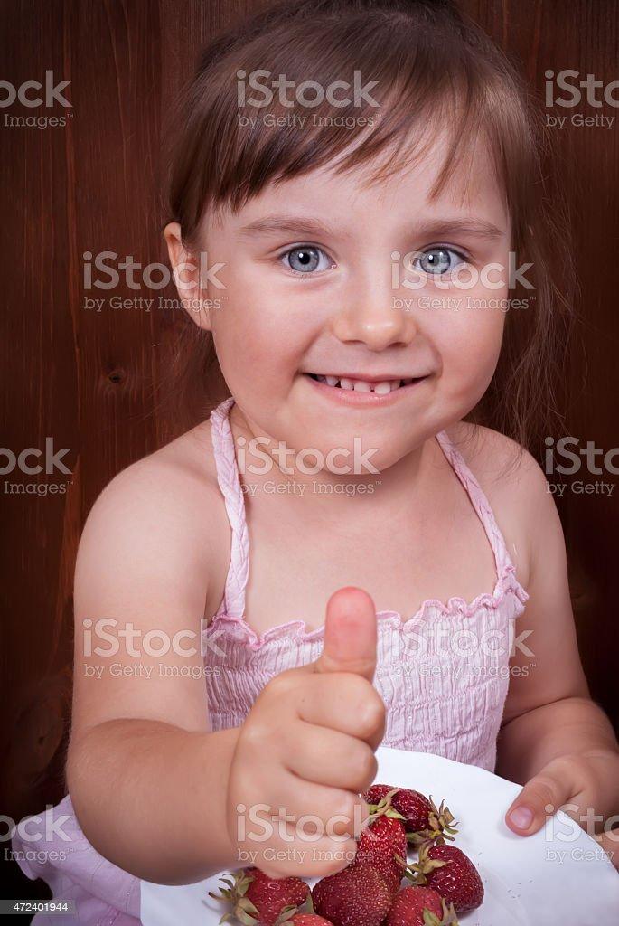 Happy little girl with tumb up stock photo