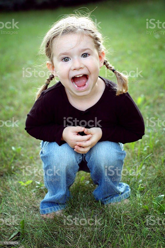 Happy Little Girl Yelling Outside royalty-free stock photo