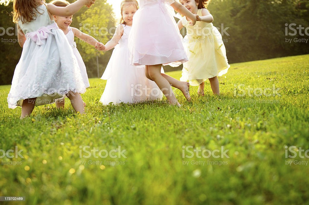 Happy Little Girls Dancing in a Circle Outside royalty-free stock photo