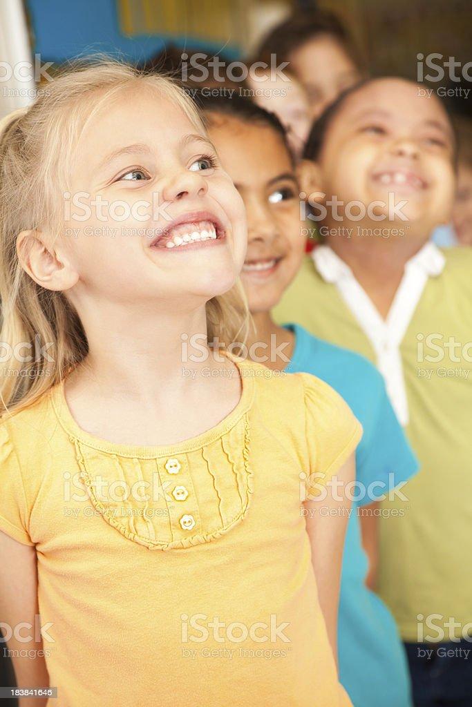 Happy Little Girls in School Line Outside Classroom royalty-free stock photo