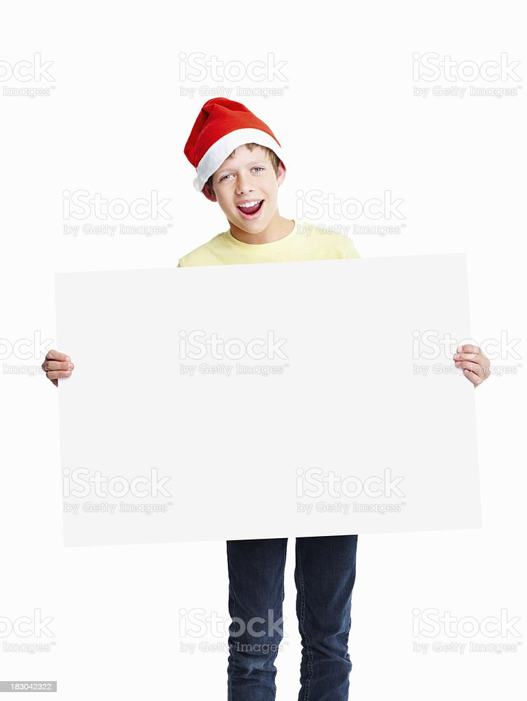 Happy little kid wearing Santa hat with sheet against white royalty-free stock photo