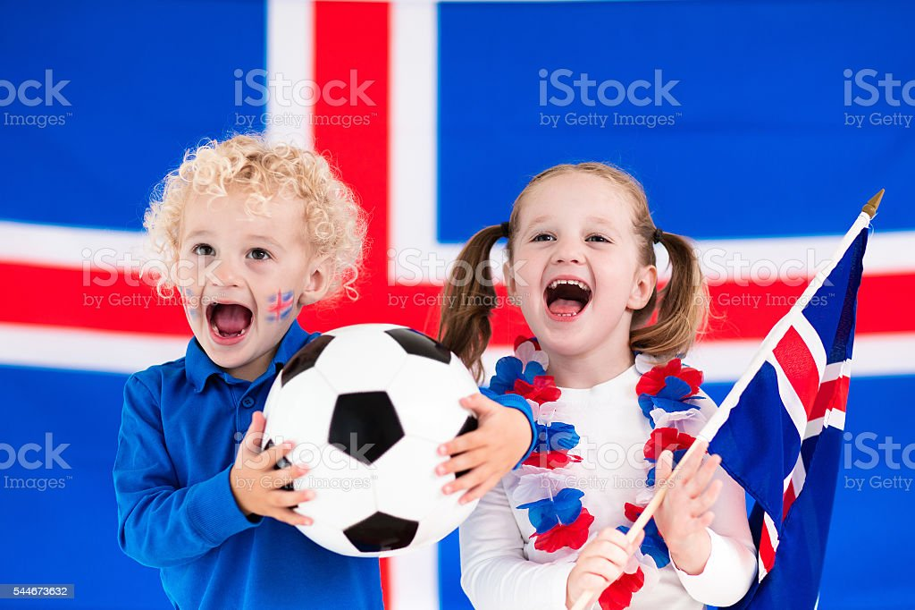 Happy little kids, Iceland football supporters stock photo