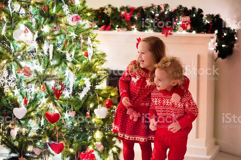 Happy little kids under Christmas tree stock photo