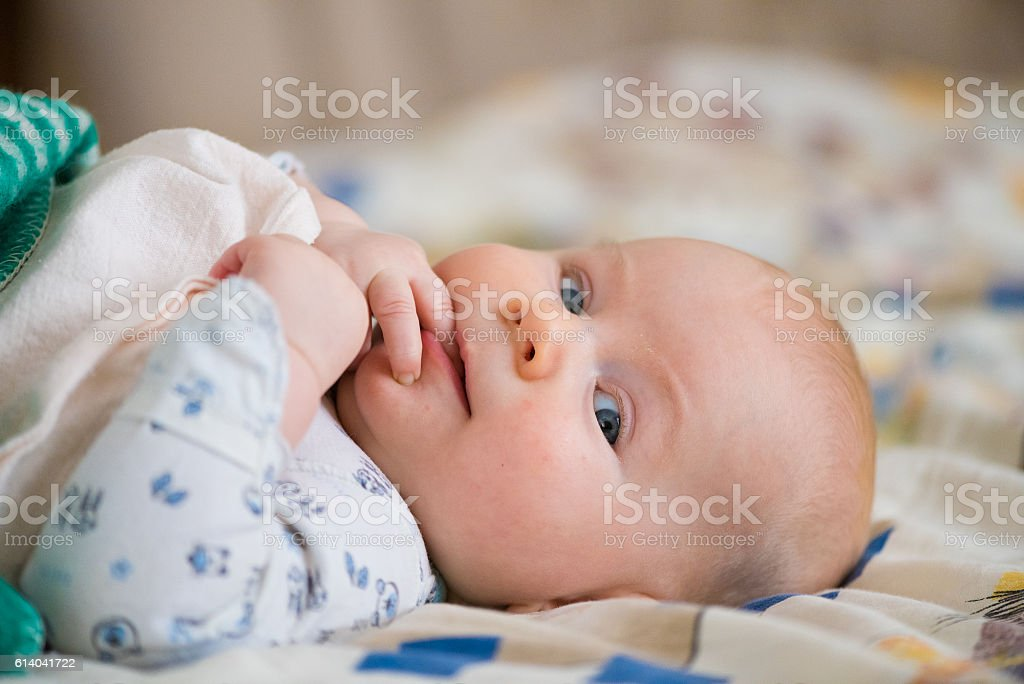 happy little smiling baby looking at camera stock photo