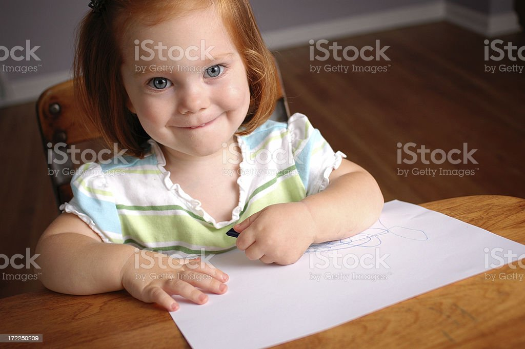Happy Little Student in School Desk with Paper royalty-free stock photo