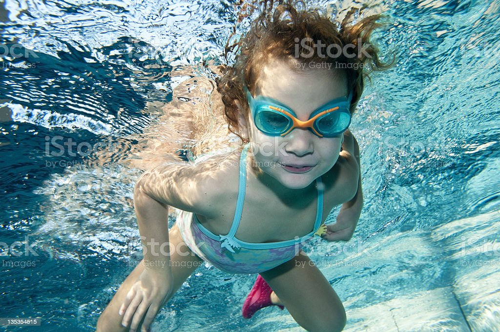 happy little toddler girl swimming underwater royalty-free stock photo