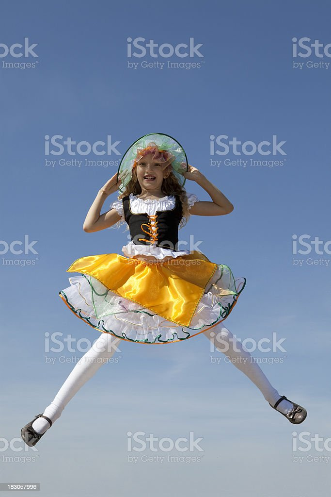 Happy Little Witch Jumping at the Blue Sky royalty-free stock photo
