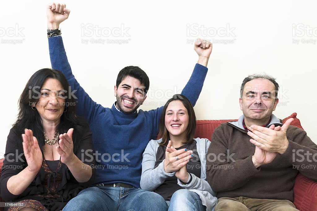 Happy lovely family in front of the TV royalty-free stock photo